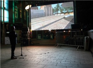 Boy playing with Lawrence Lek's DalstonMonAmour in 2015 in Gillett Sq