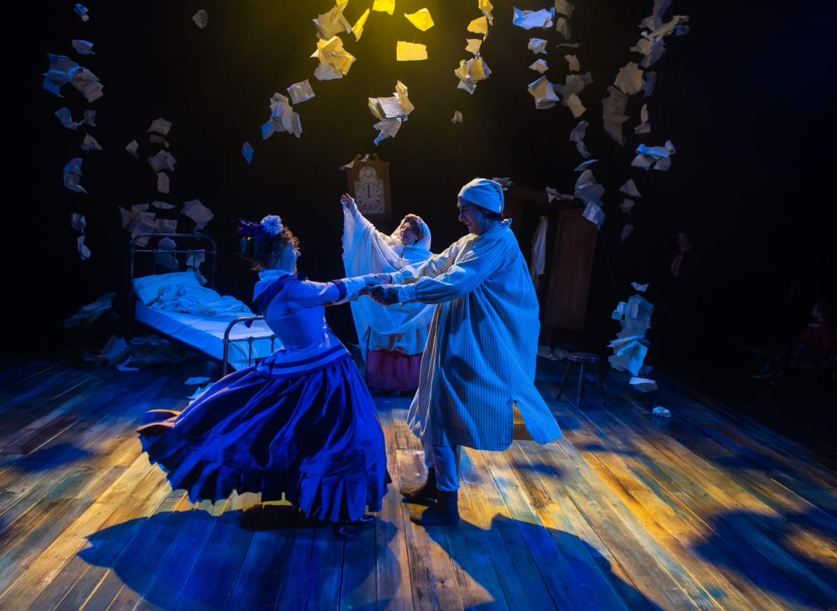 Amy Drake as Belle (left), Kerry Peers as Ghost of Christmas Past (centre) and Steven Elliott as ...