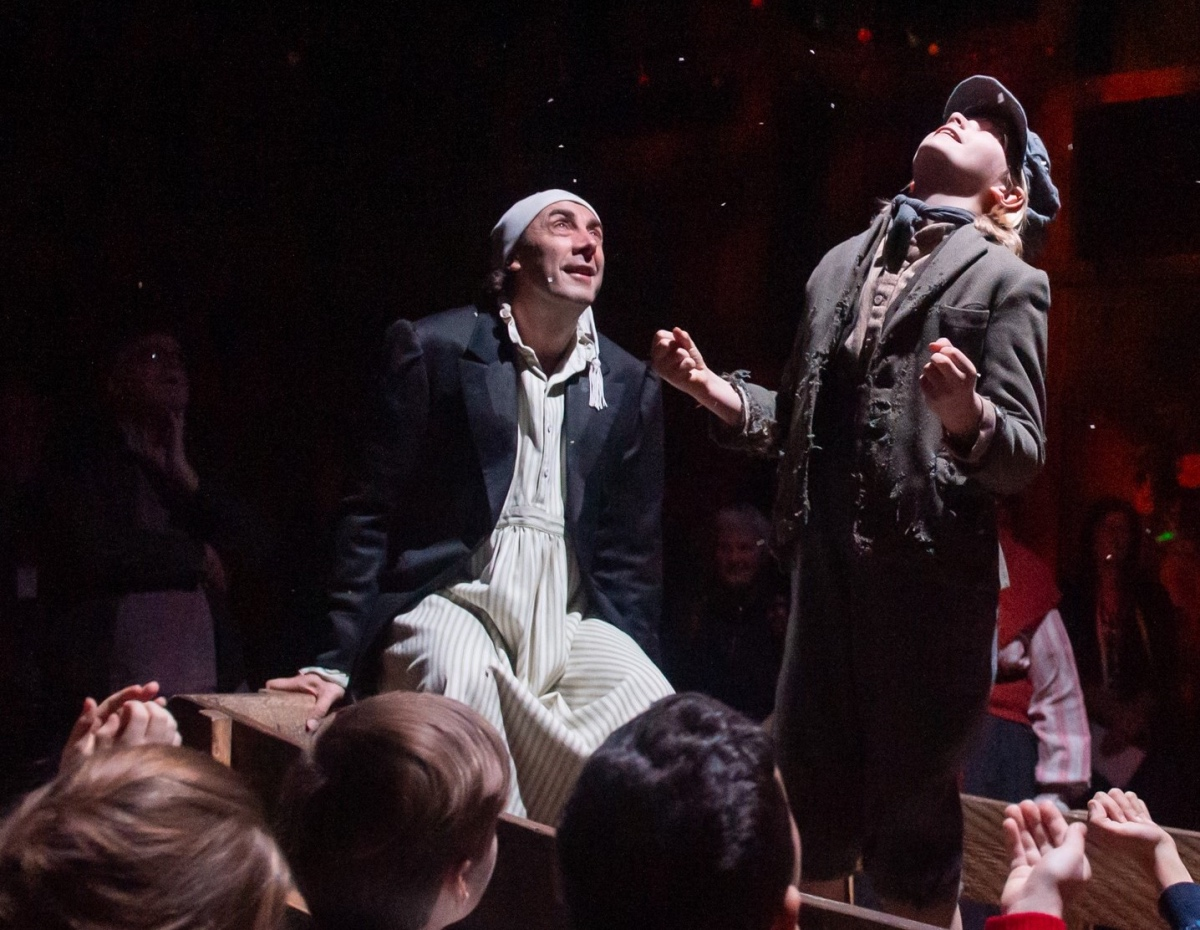 Steven Elliott as Scrooge and Dylan Roberts as Tiny Tim. A Christmas Carol. Theatr Clwyd 2019 ...